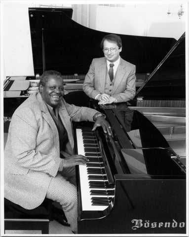 Oscar Peterson buying a Bosendorf piano at Remenyi House in 1981