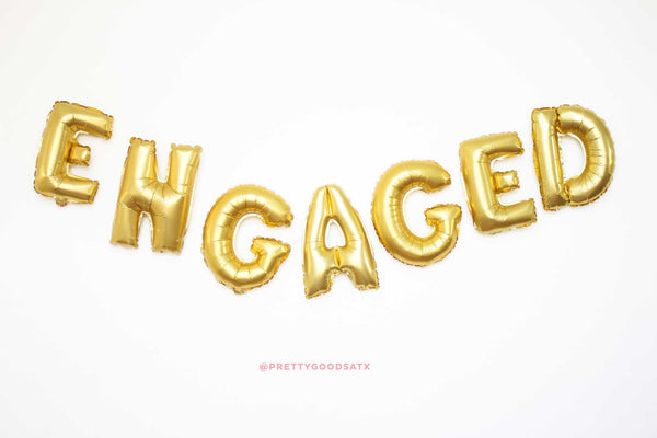 Engaged gold letter balloons