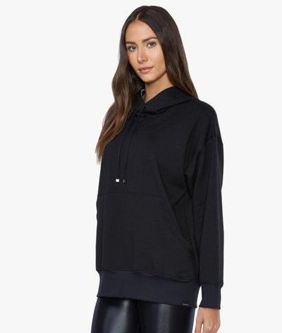 Women's black gym hoodie by Koral. Super soft, super luxe.
