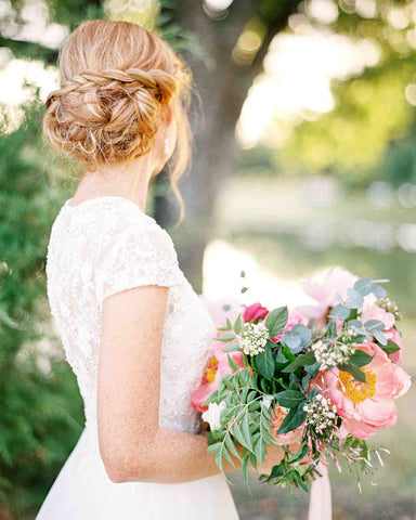 bateau wedding dress braided bun hairstyle