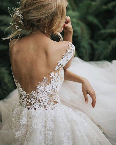 open back wedding dress messy bun wedding hairstyle