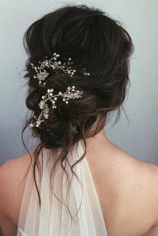 boho messy bun wedding hairstyle