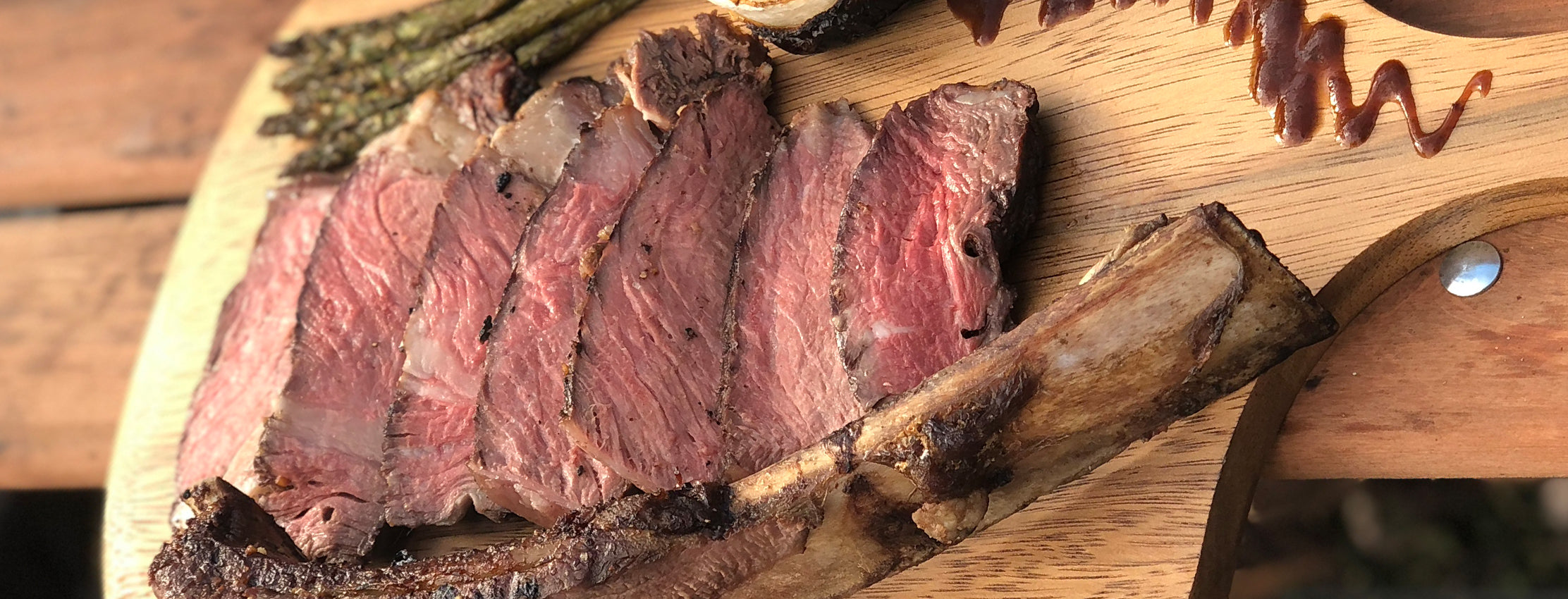Cowboy Steak with Asparagus and Onion