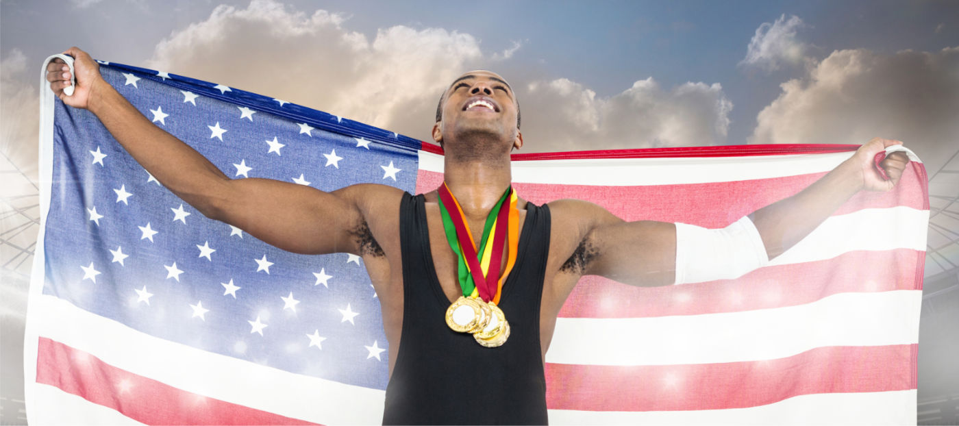 athlete with American flag and gold medals