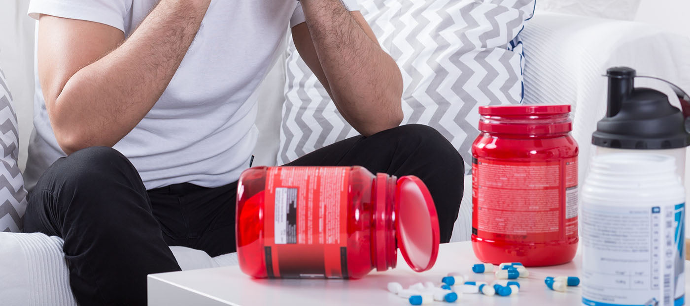 man taking fitness supplements