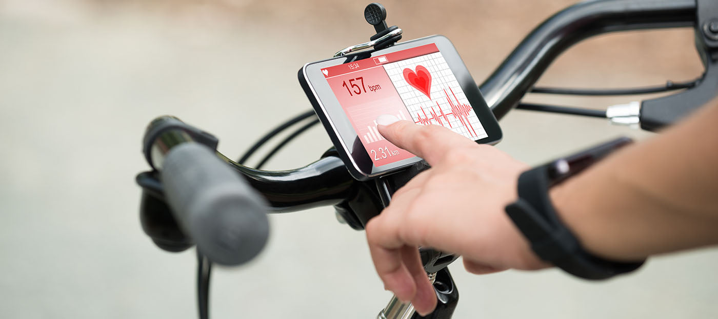 cyclist checking heart rate