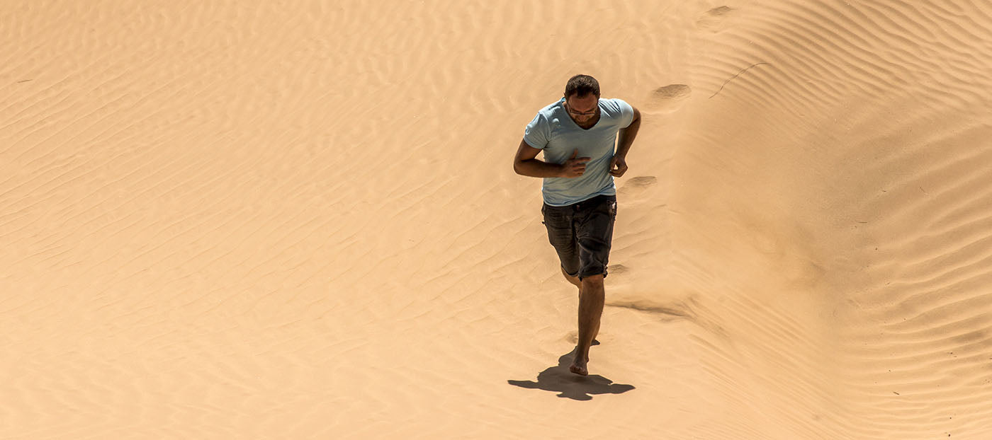 Man running in sand