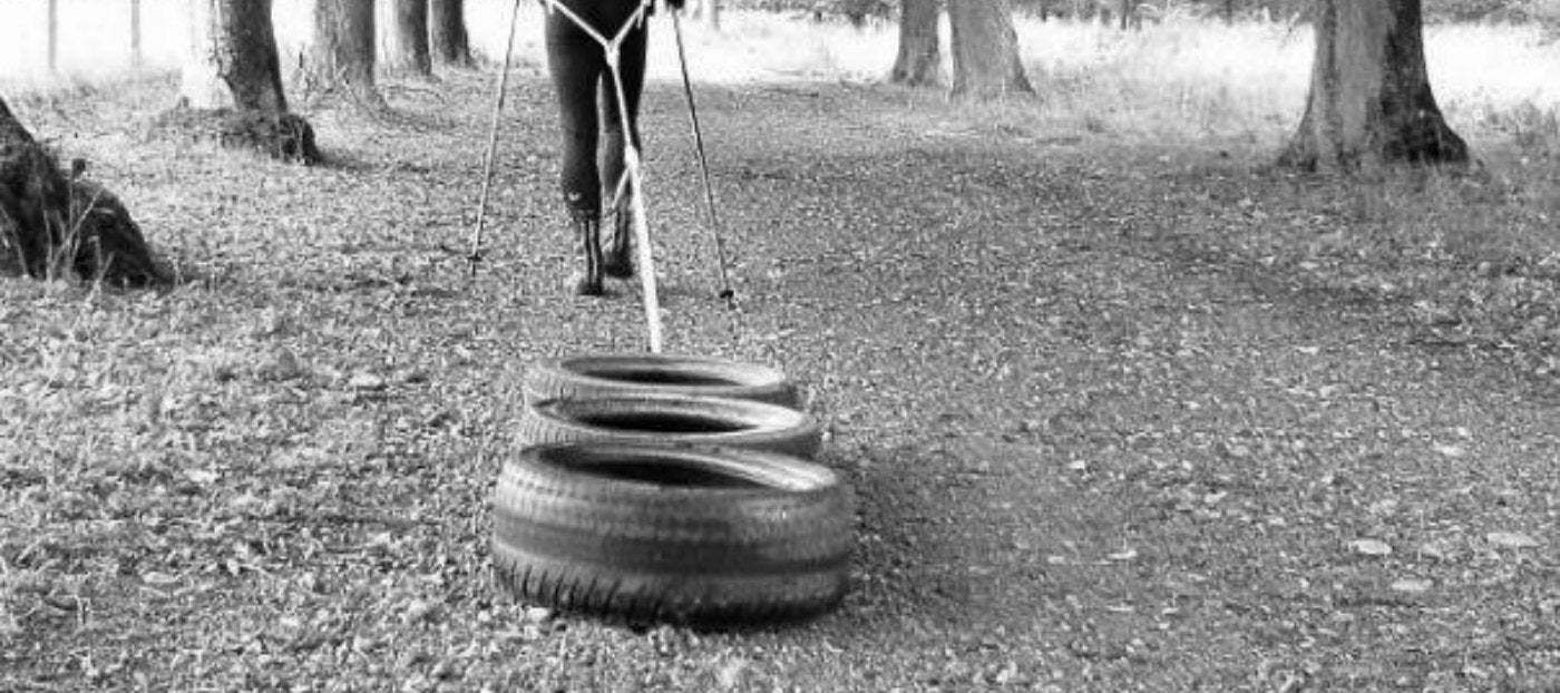 athlete pulling tires