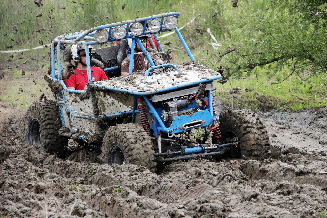 Offroad race - 4x4 car driving through mud