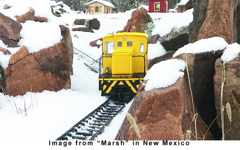 38501 Clean Machine is working away on a snow covered layout in New Mexico