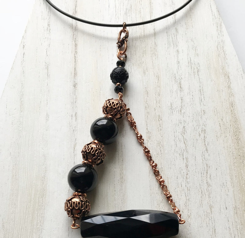 Statement necklace with semiprecious black onyx and copper metals