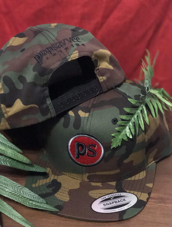 "Pop Savvee Clothing Hats OSFA / Military Green Camo / Cotton/Polyester Military Camo Snapback Hat With Plastic Snap and Red ""Pop Savvee Clothing"" Logo"