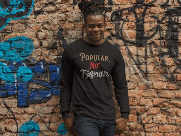 "Pop Savvee Clothing Shirts S / Black / Combed/Ringspun Cotton Unisex Long Sleeve Crewneck T-Shirt With ""Popular Not Famous"" Logo"