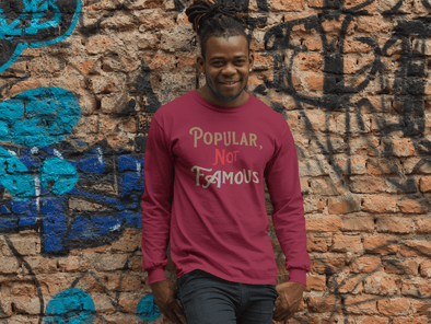 "Pop Savvee Clothing Shirts S / Heather Cardinal / Combed/Ringspun Cotton Unisex Long Sleeve Crewneck T-Shirt With ""Popular Not Famous"" Logo"