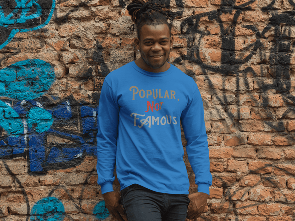 "Pop Savvee Clothing Shirts S / Royal Blue / Combed/Ringspun Cotton Unisex Long Sleeve Crewneck T-Shirt With ""Popular Not Famous"" Logo"