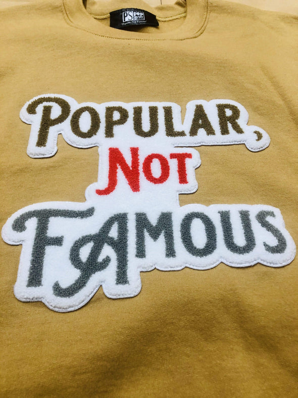 "Pop Savvee Clothing Sweatshirts S / Old Gold / Cotton/Polyester Old Gold Unisex Sweatshirt With ""Popular Not Famous"" Chenille Embroidery"