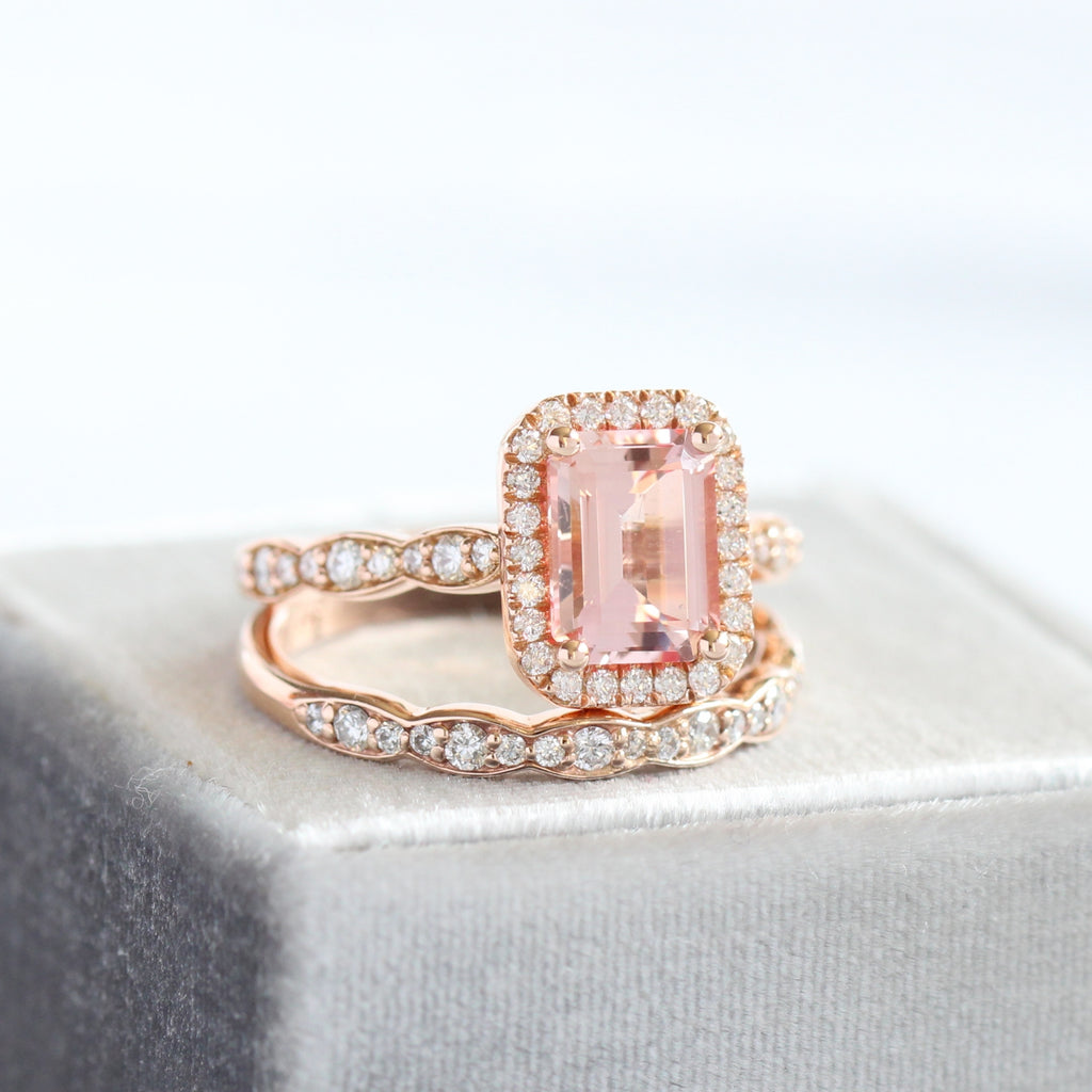 emerald cut peach sapphire engagement ring in rose gold halo diamond with a matching diamond wedding band by La More Design jewelry