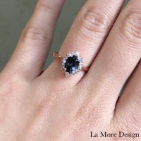 Elegant yet unique grey spinel diamond engagement ring is crafted in a 14k rose gold tiara halo diamond ring setting featuring a 1.33-carat oval cut natural grey spinel center encircled by a halo of brilliant white diamonds to create the truly one of a kind look ~ the total gemstone and diamond weight of the whole ring is 1.63 ct.tw.