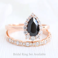 Black spinel diamond pear engagement ring rose gold and matching diamond wedding band by la more design jewelry