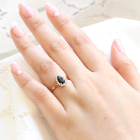Black spinel pear engagement ring rose gold halo diamond ring by la more design jewelry
