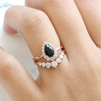 Black spinel diamond pear engagement ring rose gold and curved large diamond wedding band by la more design jewelry