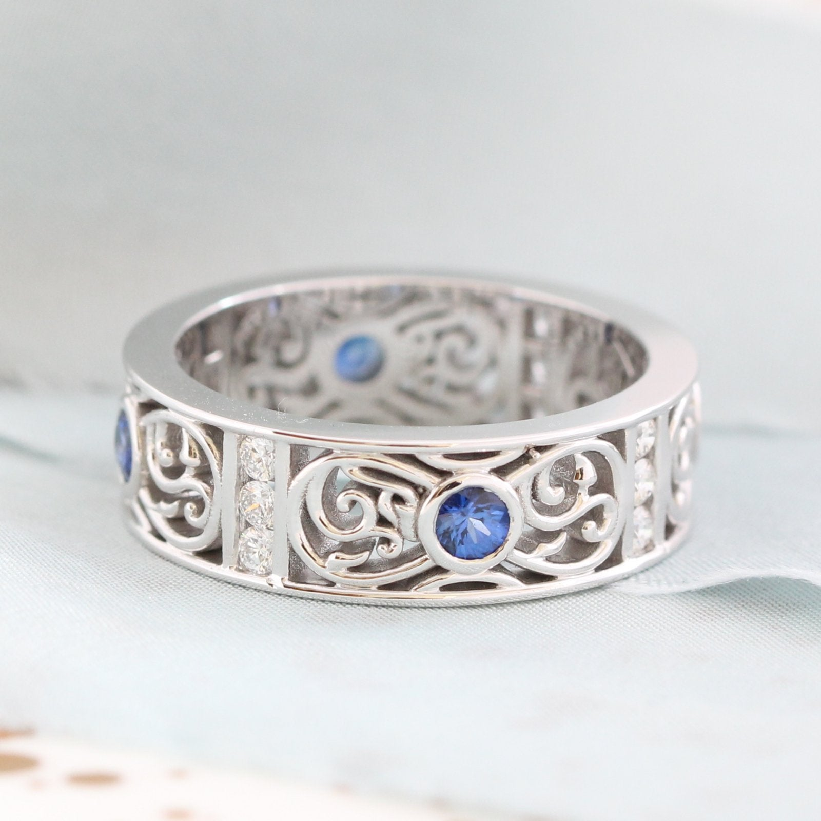 Diamond And Round Cut Sapphire Celtic Knot Wedding Band In 14k White