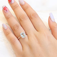 Emerald cut aquamarine engagement ring in rose gold halo diamond ring by la more design jewelry