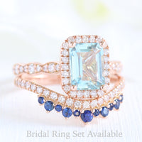 Emerald cut aquamarine halo ring and crown diamond and sapphire wedding band in rose gold bridal set by la more design jewelry