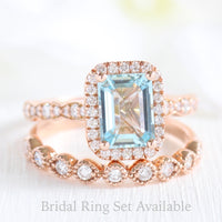 Emerald cut aquamarine halo ring and milgrain diamond wedding band in rose gold bridal set by la more design jewelry