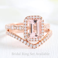 Emerald cut morganite halo ring and contoured diamond wedding band in rose gold bridal set by la more design jewelry