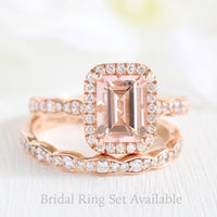 Emerald cut morganite halo ring and matching diamond wedding band in rose gold bridal set by la more design jewelry