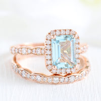 Emerald cut aquamarine halo ring and matching diamond wedding band in rose gold bridal set by la more design jewelry