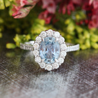 Natural aqua blue sapphire engagement ring in 14k white gold by la more design