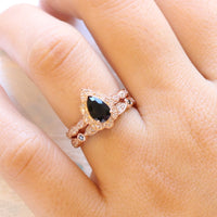 Halo black diamond pear engagement ring rose gold and matching diamond wedding band by la more design jewelry