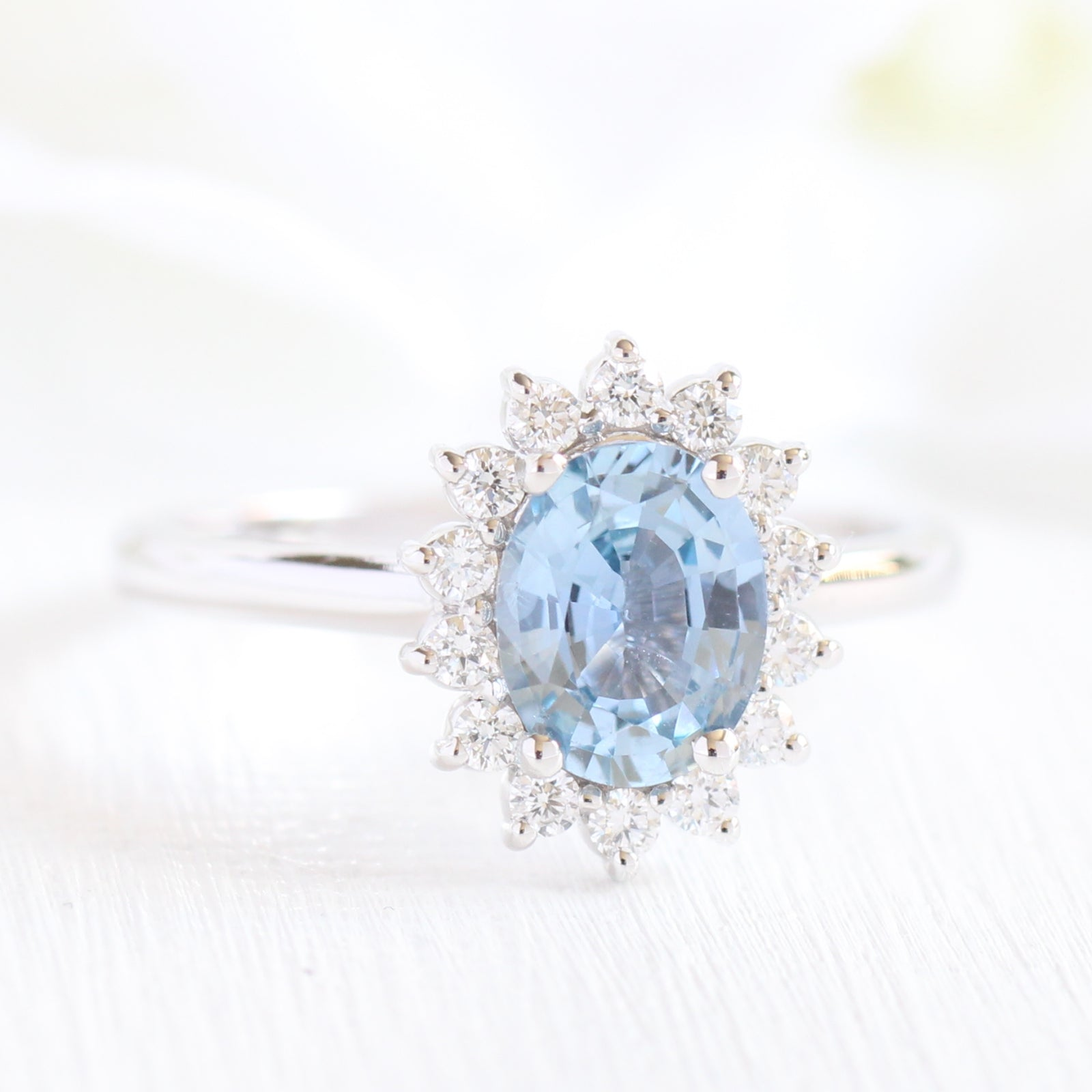 halo heart light pin with ring shaped blue engagement sapphire diamond