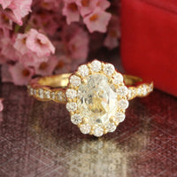 Natural yellow sapphire engagement ring in 18k yellow gold by la more design