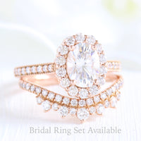 oval moissanite halo ring and crown diamond wedding band in rose gold bridal set by la more design jewelry