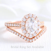 oval moissanite halo ring and curved diamond wedding band in rose gold bridal set by la more design jewelry