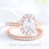 oval moissanite halo ring and matching diamond wedding band in rose gold bridal set by la more design jewelry