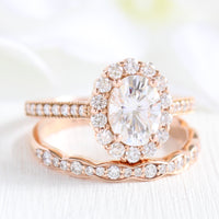oval moissanite halo ring and scalloped diamond wedding band in rose gold bridal set by la more design jewelry