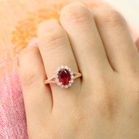 oval ruby ring in rose gold vintage halo diamond band by la more design