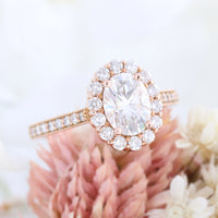 Oval moissanite engagement ring in rose gold halo diamond ring by la more design