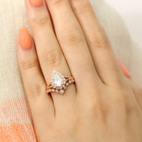 Pear moissanite ring bridal set in rose gold vintage inspired diamond band by la more design