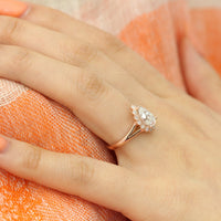Pear moissanite engagement ring in rose gold vintage inspired diamond band by la more design