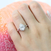 Pear moissanite engagement ring in white gold vintage inspired diamond band by la more design