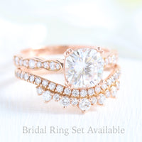 Solitaire cushion moissanite ring and curved crown diamond wedding band in rose gold bridal set by la more design