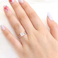 Solitaire cushion moissanite ring and matching diamond wedding band in rose gold bridal set by la more design jewelry