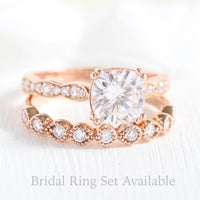 Solitaire cushion moissanite ring and milgrain diamond wedding band in rose gold bridal set by la more design