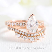 Solitaire pear moissanite ring and crown diamond wedding band in rose gold bridal set by la more design
