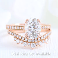 Solitaire pear moissanite ring and curved crown diamond wedding band in rose gold bridal set by la more design